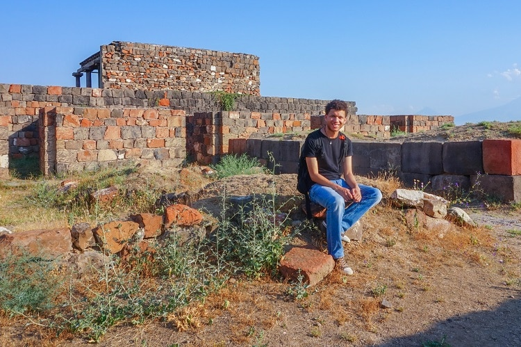A quick breather on the ruins of the Granary. Erebuni Fortress, Armenia